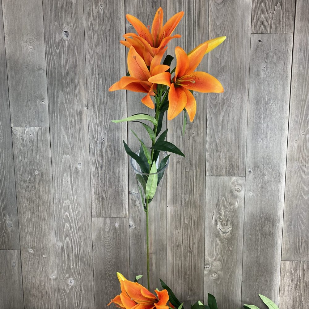 single artificial orange lily stem