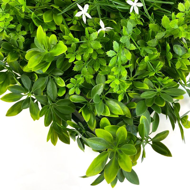 Mixed foliage artificial hedging tile close up