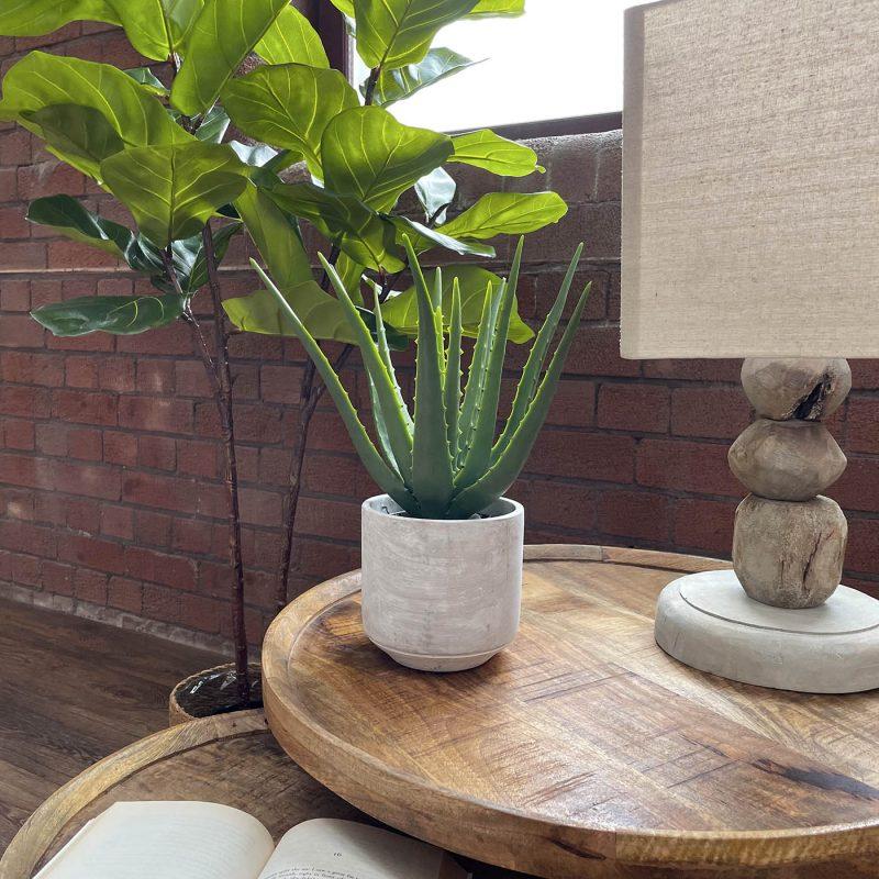 small artificial aloe vera plant in a ceramic pot