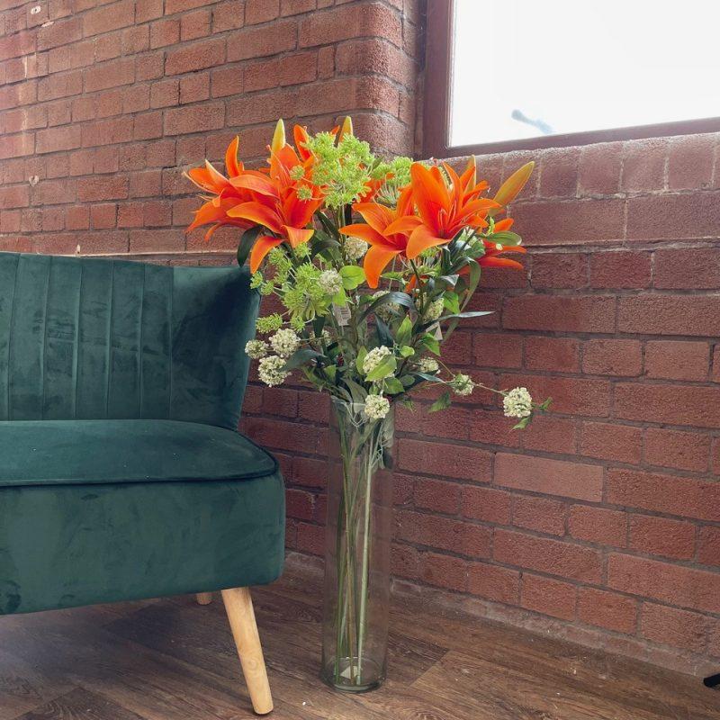artificial orange lily display
